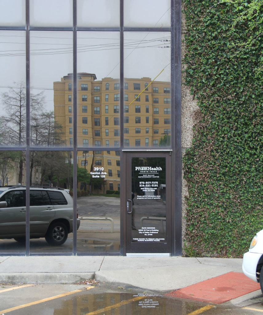 image of a glass door with the address of East Dallas Empowerment Center etched on